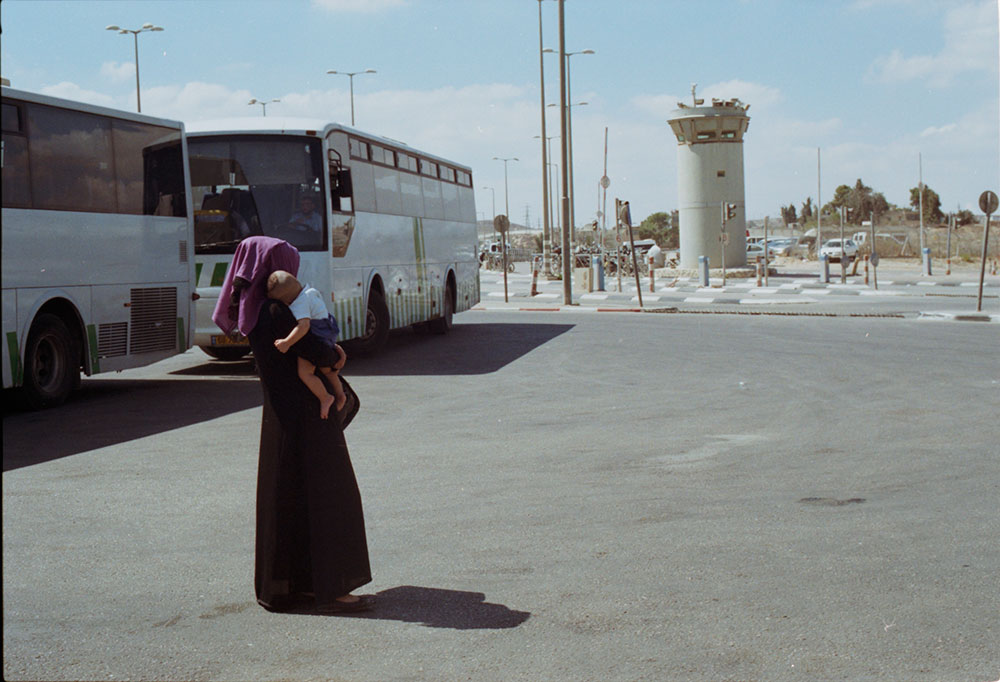 A Woman and Child at Qalandiya Checkpoint