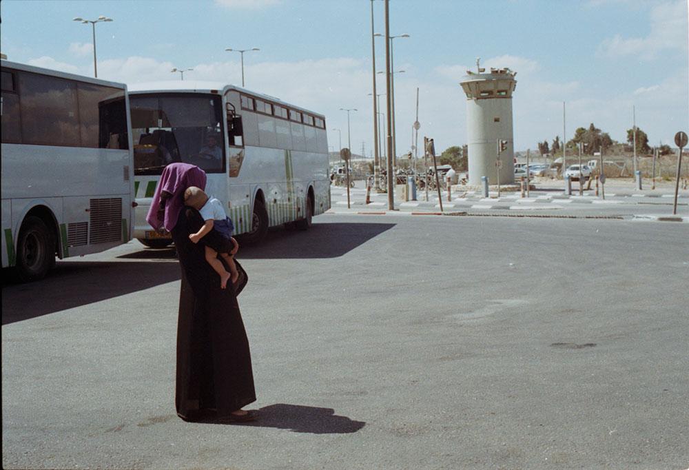 A Woman and Child at Qalandiya Checkpoint