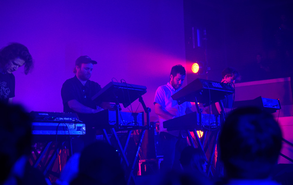 4 white guys with synths –that must be Survive